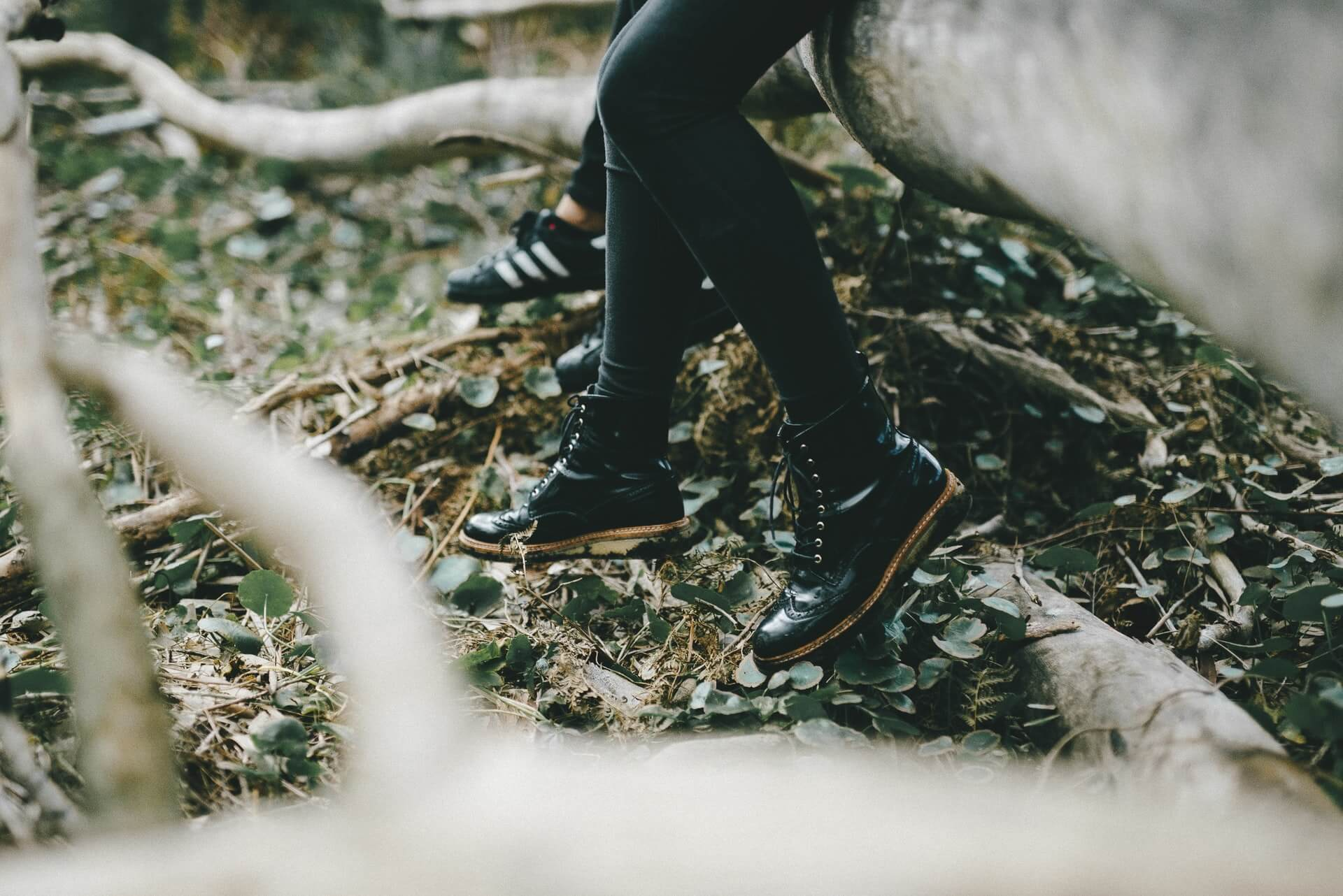 Black boots in a green forest