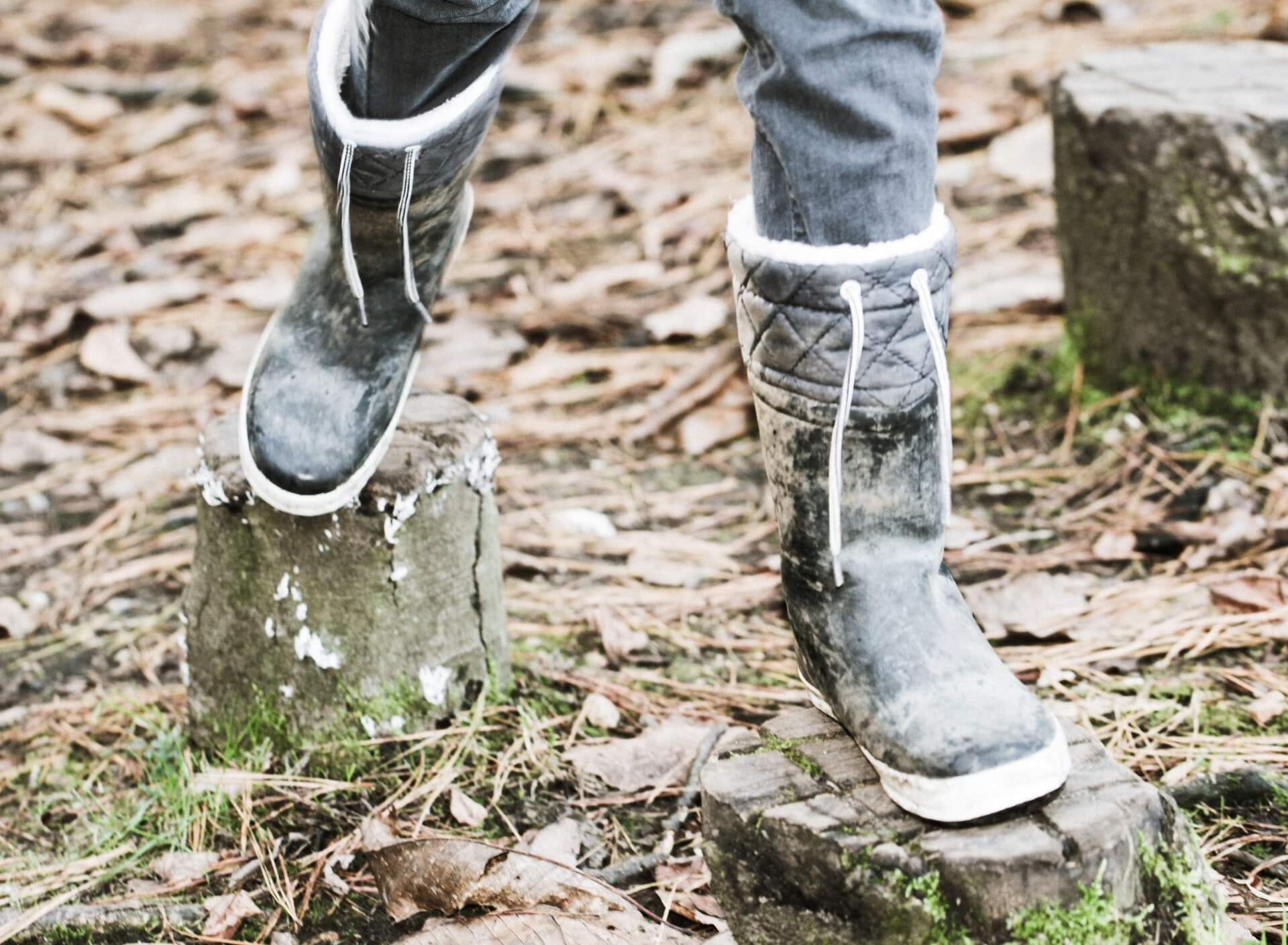 Closeup of warm rubber boots in the woods