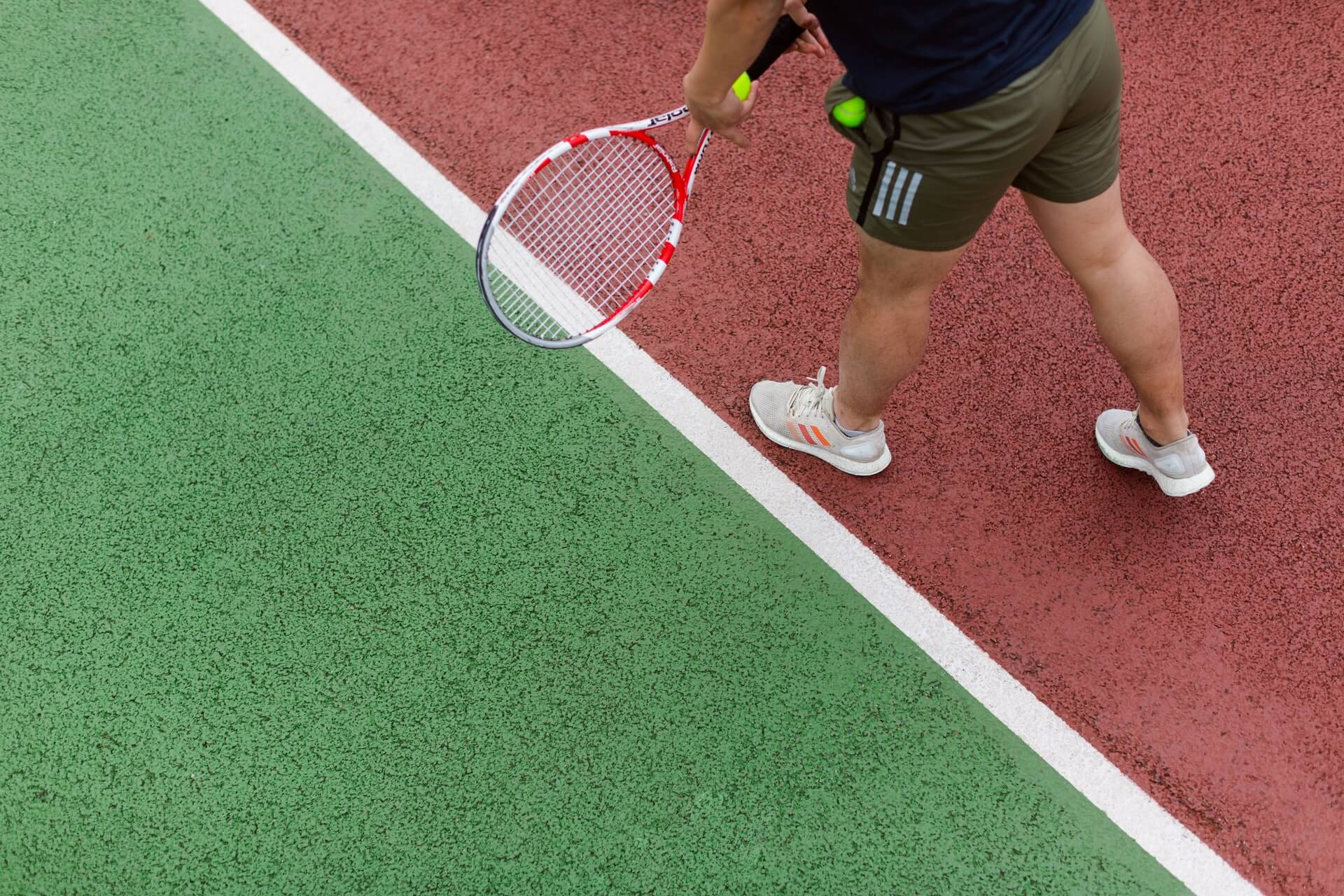 Closeup of person playing tennis