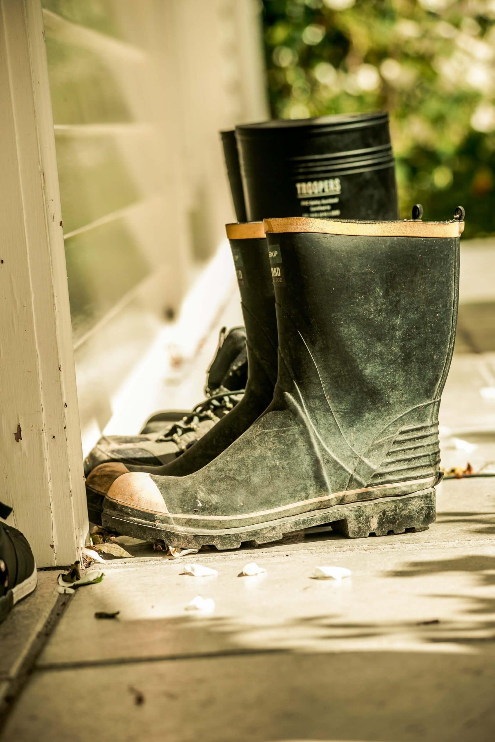 Closeup of two pairs of Wellington boots