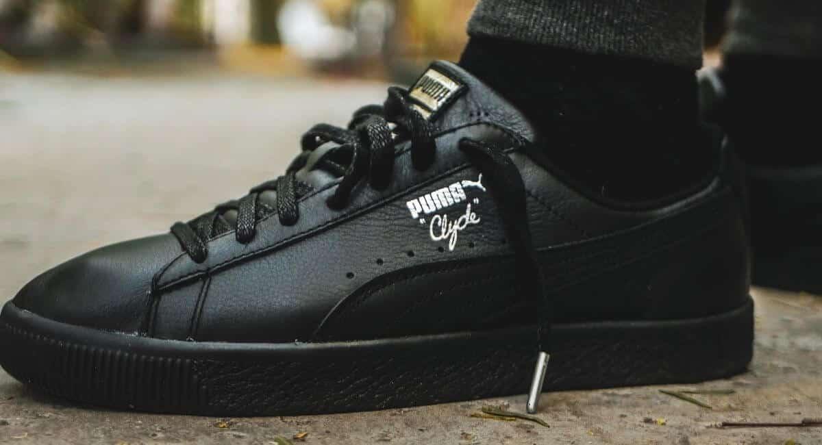Closeup of black Puma Clyde shoes