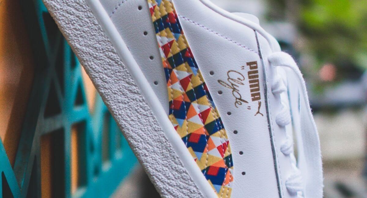"Closeup of a white ""Puma Gold"" shoe"