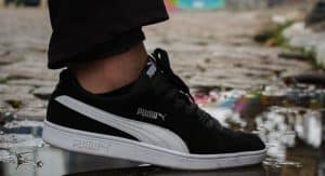 Puma shoe stepping in a puddle