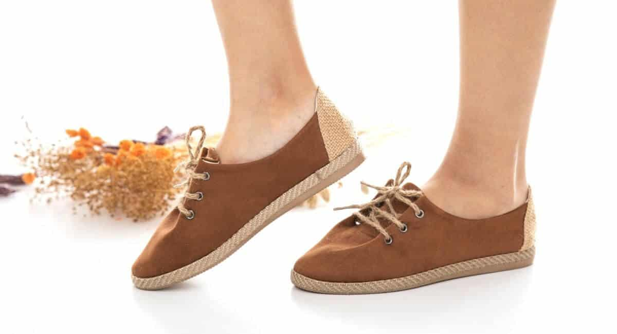 Woman wearing brown canvas shoes