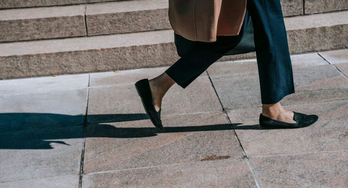 Woman walking down the street in flat shoes