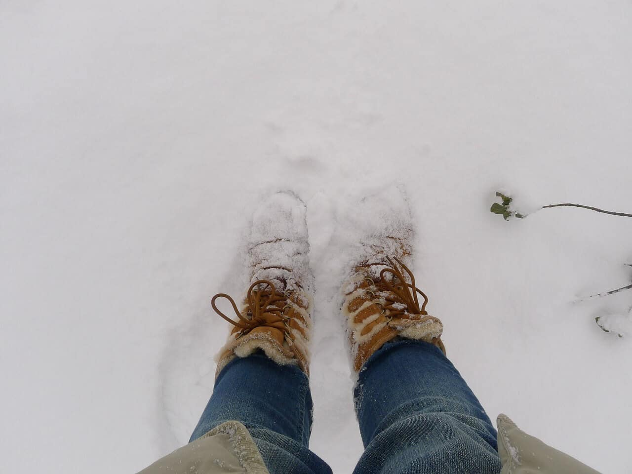 a person wearing a pair of furry uggs in the snow