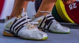Man lifting weights, closeup of his feet