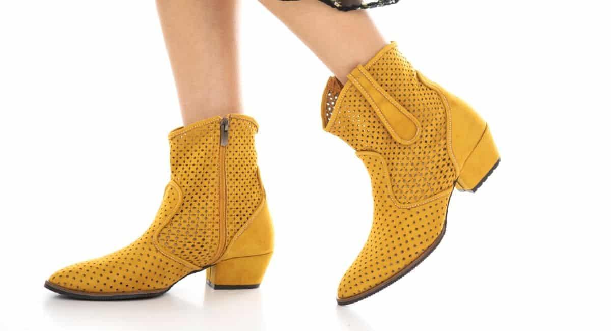 Woman wearing yellow boots